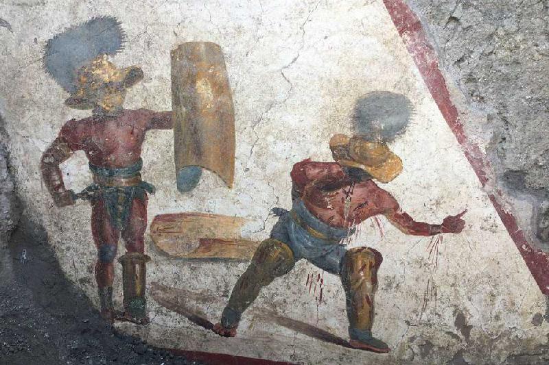 L'affresco dei Gladiatori combattenti – Una nuova eccezionale scoperta dagli scavi della Regio V di Pompei